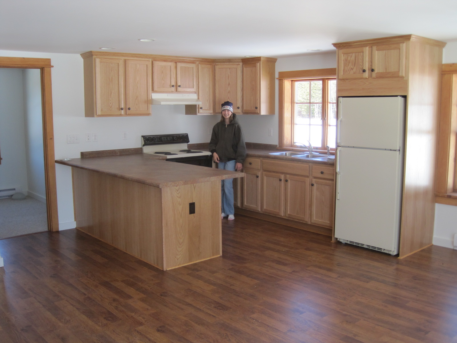 Laminate flooring lay laminate flooring australia for Are kitchen cabinets installed on top of flooring